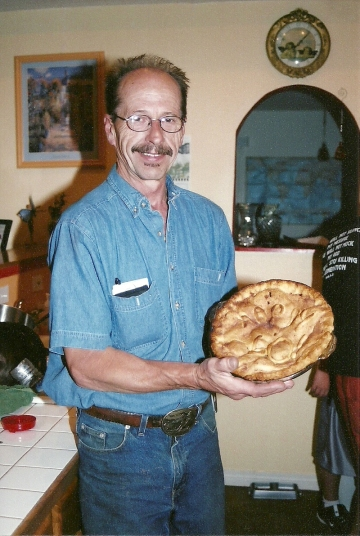 My dad with his birthday pie... 2004