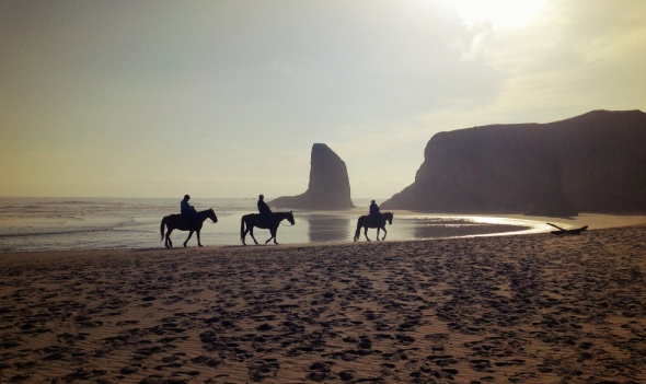 Riders enjoying their journey across the beach in Bandon, Oregon. Photo by Jaklyn Larsen